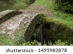 Stone Footbridge Over A Small...