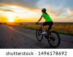 Beautiful girl cyclist riding a ...