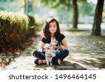 Stock photo asian young girl holding a mother cat and kittens in the park under the sun pet and domestic 1496464145