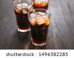 Glasses Of Cold Cola On Wooden...