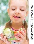 little girl eating vegetable...   Shutterstock . vector #149661752