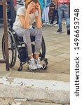 Small photo of Woman in a wheelchair in front of an insurmountable obstacle.