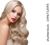Small photo of Beautiful blonde in a Hollywood manner with curls, natural makeup and red lips.. Beauty face and hair