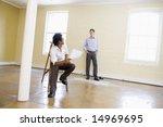 man sitting on ladder in empty... | Shutterstock . vector #14969695