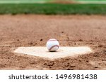 Baseball Laying On A Worn Home...