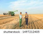 Male farmers working in wheat...
