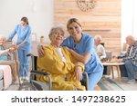 Nurse With Elderly Woman In...