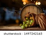 Small photo of Beer brewing ingredients Hop in bag and wheat ears on wooden cracked old table. Beer brewery concept. Hop cones and wheat closeup. Sack of hops and sheaf of wheat on vintage background.
