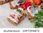 Stock photo delicious canapes with herring macro of delicious canape or sandwiches with fresh herring black 1497294872