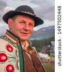 Tatry, Poland - June 03, 2019: An ethnic highlander (Góral)  in traditional goral dress with black hat in Polish Tatra mountains. Goral from Zakopane. Eastern Europe - stock photo