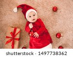 Cute baby girl in red santa...