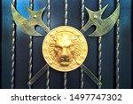 A Golden Lion\'s Head On A Roun...