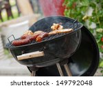 meat is baked on a hot grill. | Shutterstock . vector #149792048