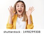 Small photo of Emotive excited screaming asian blond girl yell about amazing shocking surprising great news shaking hands astonished smiling joyful delighted open mouth gasping incredible excellent opportunity