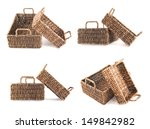 Composition of two brown wicker baskets, box shaped, isolated over white background, set of two foreshortenings - stock photo