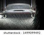 Vehicle in Automatic Car Wash. Washer Brushes and Spraying Water with Body Cleaning Detergent.  - stock photo
