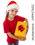 Smiling girl in Santa hat with yellow gift box, isolated on white - stock photo