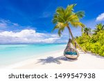 Small photo of Tropical beach background as summer landscape with beach swing or hammock and white sand and calm sea for beach banner. Perfect beach scene vacation and summer holiday concept. Boost up color process
