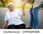 Small photo of Asian elderly woman fell to the floor after tripped over something,female caregiver or daughter help,care,support to her in nursing home,sick senior mother skid,falling down because of dizziness,fain