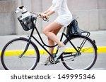 Side shot of woman on bike - stock photo