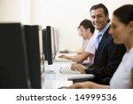 four people in computer room... | Shutterstock . vector #14999536
