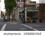 Small photo of Portland, Oregon/United States – 4/25/2019: The 711 store located on SW 4th ave in downtown Portland; people without a home loiter here asking for change from customers.