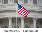 Us Flag On Capitol Building...