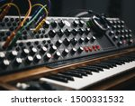 Small photo of Synthesizer board and headphones in sound recording studio.Professional hi-fi audio equipment for music producer.Retro analog synth device for producing new musical tracks in high quality