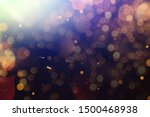 Small photo of Abstract Golden glare on abstract bokeh background