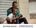 Handsome Young Father Sitting...