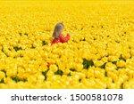 Girl Running In A Yellow Tulip...