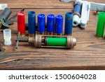 Small photo of reloading process shotgun shells with special reload equipment. Powder, bullets, fraction, shells, buckshot on the wooden background