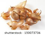 Bulbs of Golden Shallots over white background. - stock photo