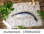 Stock photo salted herring with onion and parsley on the old wooden background fresh herring fish 1500816632