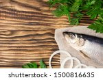 Stock photo salted herring with onion and parsley on the old wooden background fresh herring fish copy space 1500816635