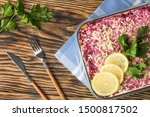Stock photo herring under fur coat traditional russian salad herring under a fur coat vintage wood background 1500817502