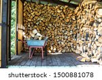 A Cart With Firewood In A...
