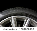 Small photo of Close up of Number code on sidewall of car tyre with alloy wheel, Tyre Sidewall Markings.
