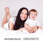beautiful young mother with her ... | Shutterstock . vector #150120272