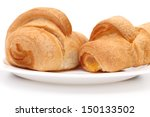 Group of Croissants on Saucer - stock photo