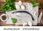 Stock photo salted herring with onion and parsley on the old wooden background fresh herring fish copy space 1501648262