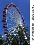 red ferris wheel in summer.     ...   Shutterstock . vector #150168752