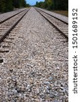 Railroad Tracks With Three Rai...