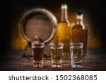 Small photo of alcoholic beverages, cachaca, drips, rum and brandy. Selection of strong and hard alcoholic drinks, glasses. Vodka, brandy, tequila, brandy and whiskey, grappa, liqueur, vermouth, tincture, rum.