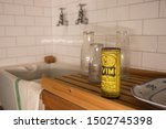 Small photo of 09/12/2019 Portsmouth, Hampshire, UK A scene from a 1960's kitchen with tiles, a butler sink, wooden draining board and Vim cleaning powder
