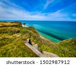 Small photo of D-Day at Pointe du Hoc is a promontory in Normandy, stormed and escalated on June 6, 1944 by the American Rangers as part of Operation Overlord during World War II. Located on a cliff 100 ft cliff.