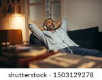 Mid aged man listening music...