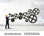 businessman with cog wheel... | Shutterstock . vector #150333626