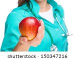Lady doctor is holding a red apple, isolated over white - stock photo