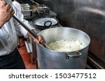 stirring commercial cooking pot ...